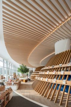 The Florescence | Karv One Design Amazing Architecture, Interior Architecture, Luz Natural, Book Bar, Glass Curtain Wall, Library Design, Display Design, Commercial Interiors, Ceiling Design