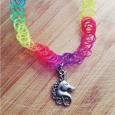 Grunge 90s, thin rainbow unicorn tattoo charm choker, unicorn,... ($5) ❤ liked on Polyvore featuring jewelry, necklaces, animal necklace, multicolor necklace, animal charms, multi color necklace and choker necklace
