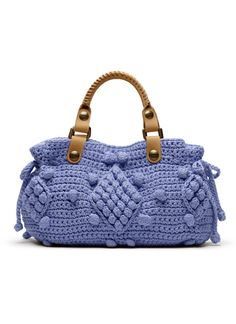 Same pattern as the grey purse, different color and handles. So cute this way!
