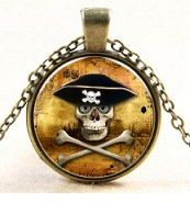 "ARRR this is a cool necklace for pirate lovers and fans! Cartoon Pirate Skull & Crossbones With Pirate Hat~Vintage Look~1 Inch Round Antique Brass Glass Cabochon Necklace. Comes with matching antique brass 18"" chain with extender area. How fun! #NoahsArkBowtique #pirates #apirateslifeforme"