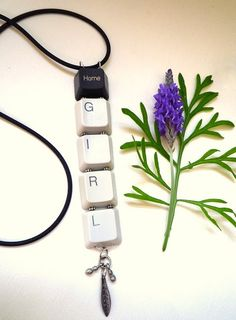 keyboard letters turned into fashionable necklaces. :)  I love this blog.