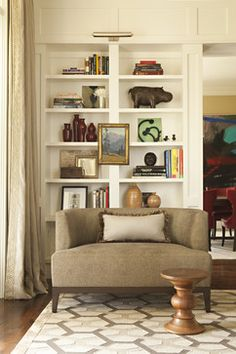 A well-curated bookshelf can complete the look of a wall in a highly personalized way. Mix stacking techniques and add unique decorative items as a final finishing touch.
