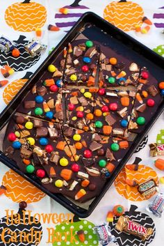Halloween Candy Bark - a great way to use up leftover candy! From The Girl In The Little Red Kitchen