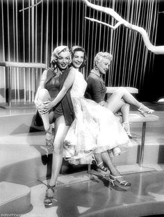 Marilyn Monroe, Lauren Bacall, and Betty Grable on the set of How To Marry A Millionaire.