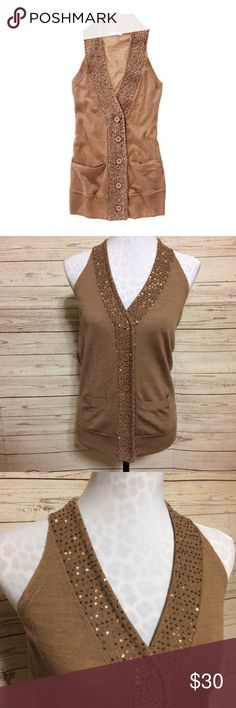 Madewell Sweater Vest 100% merino wool sweater vest by Madewell (Wallace) in flawless condition. Sleeveless vest with sequin neckline and button placket. Two front pockets. V-neckline. Soft and cozy! Hits below hips. Looks great with a mock turtleneck and jeans, and the beautiful camel color goes with nearly everything! Madewell Sweaters