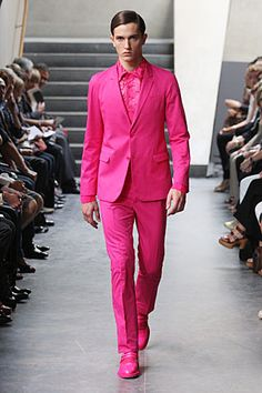 Bold, but -awesome-. Certain men can pull this off. But this is pure masculine candy. Black and pink go well together, on a man, too. If it's worn in a stylish fashion.