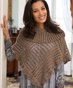 Stay warm and toasty in this crocheted lace poncho. The neutral colour ensures it will work with everything in your wardrobe.