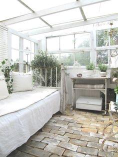 Cozy outdoor indoor sun room, green house