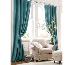 Teal curtains, brass holder & rod