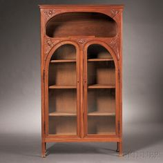 Art Nouveau Bookcase Fruitwood France, c. 1900 Rectangular top over oval open compartment with carved floral detail over two glass doors within a curvilinear framework, interior fitted with three shelves, shaped feet. Art Nouveau Furniture, Antique Furniture, Dream Furniture, Belle Epoque, Gaudi, Jugendstil Design, Liberty Furniture, Art Nouveau Design, Arts And Crafts Movement