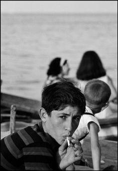Ferdinando Scianna Sicily, Palermo, young boy smoking,1964