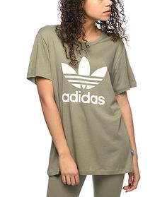 Shop the latest trends to find the adidas Trefoil Boyfriend T-Shirt. Featured here in a muted olive green color and finished with the iconic adidas Trefoil logo printed on the front.
