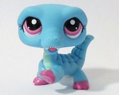 Blue crocodile/alligator bobble head with light pink and dark hot pink/purple eyes, dark hot pink/purple feet, and light green-teal throat and belly.