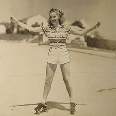 -- betty grable / printed shirt + high-waisted short with distinct button detail.