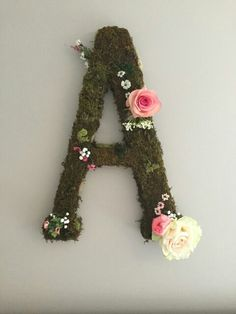 "24"" paper mache letter covered with moss and decorated with artificial flowers to compliment our daughter's nursery. Get yours from our store on Etsy! Follow the link"