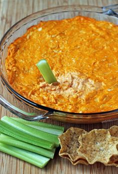 This easy, 5 ingredient lightened up Buffalo Chicken Dip is a crowd-pleaser for parties! Just 105 calories or 3 Weight Watchers SmartPoints per serving. www.emilybites.com