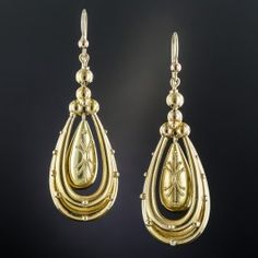 Consummate Victorian ear drops, rendered in rich 15K yellow gold, by way of late-19th century Great Britain. Measuring 1 and 7/8 inches long (they drop a bit further from the new ear wires), pendulum drops adorned with delicate Etruscan Revival style granulation swing and sway from within double tubular frames. Light and ultra-lovely. When not out and about, they reside in their original box from: 'W.D Cooper, Successor to the London Branch of James Hardy & Co. Diamond Merchants, 235…