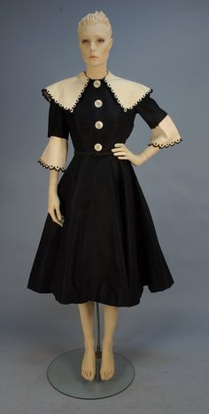 """Navy day dress with removable white linen """"pilgrim"""" collar and cuffs, by Norman Norell, c. 1950's. Worn by model Julia Solomon."""