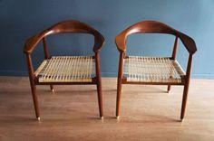 Silla vintage con asiento de palma y casquillos, estilo Hans Werner. México c. 1950. (2 piezas)