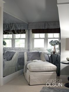 Do you have a space-challenged area in your home?  Use mirrors as a low cost way to expand the space. #candiceolson