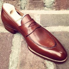 MNSWR STYLE ESSENTIALS — Embossed calf leather penny loafer from...