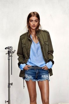 green army jacket, blue top, studded belt & cut-off jean shorts #style #fashion #denim