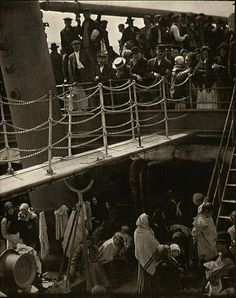 'The Steerage' by Alfred Steiglitz.  The 1907 photo captures the difference between the upper and lower-class section of a steamer going from New York to Bremen, Germany.