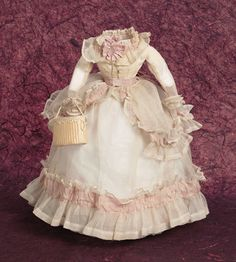 "Theriault's Antique Doll Auctions - Sheer Muslin Gown With Rose Silk Trim, Circa 1868 - Appropriately sized for poupee about 13"" - 14""."