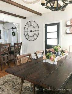 farmhouse kitchen dining room wood beams and painted dark interior door