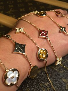 Louis Vuitton Blossom Tiger's Eye, Carnelian and mother of pearl bracelets.