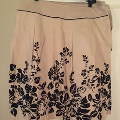 Summer Skirt Your not ready for summer till you get this cute tan and black skirt. Dress it up or wear it casual you will look cute. No stains in great condition. Covington Skirts A-Line or Full