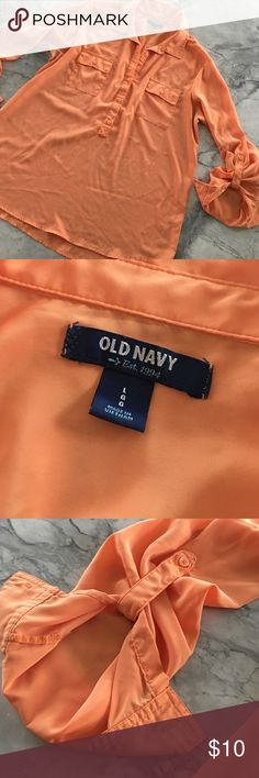 Old Navy Blouse, perfect fall tangerine color. This polyester Blouse is loose fitting, perfect with leggings or jeans. Has a beautiful orange/tangerine color. Pocket accents and sleeves that can be rolled to a 3/4 length. New condition- non smoking home. Old Navy Tops Blouses