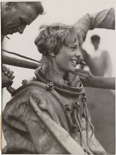 Amelia Earhart is helped out of her deep sea diving suit after exploring the bottom of the sea off Block Island. July 25, 1929.