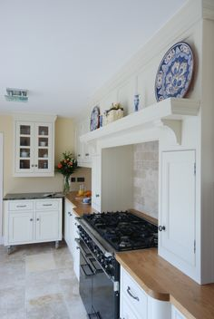 Handmade bespoke kitchen with range cooker and movable unit on wheels