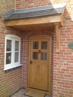 Oak canopy at Draycott in the Clay. Door Canopy Corner, Front Door Canopy, Porch Canopy, Terrace Ideas, Garden Ideas, Portico Entry, External Front Doors, Door Overhang, Outside Storage