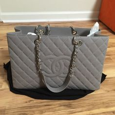 e2dad7ad7dbd Chanel Grey XL GST rare color excellent condition In excellent condition  show very light wear on the corners. Please contact me for more info.