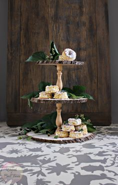 Craft a DIY triple tier cake stand, perfect for mini cakes, cupcakes doughnuts and more! This very simple to make with wood slices, cost only $20 to create!