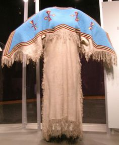 Circa 1890 Sioux Two Hide Dress with fully beaded yoke, South Dakota. Made of hide, seed beads, and sinew.