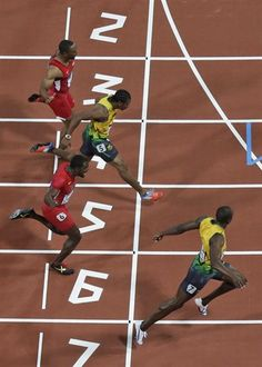Usain Bolt, bottom, crosses the finish line to win the 2012 Olympic 100 meters before Yohan Blake, and Justin Gatlin Usain Bolt Gold Medal, Yohan Blake, Justin Gatlin, Olympic Records, Nbc Olympics, Olympic Gold Medals, Fastest Man, Olympic Sports, Sport Icon