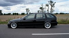 Black BMW e36 touring on cult classic OZ Hartge Design C wheels