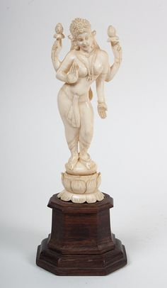 Indian carved ivory deity modeled as four-armed goddess on lotus flower, mounted on rosewood base, 10 in. Hindu Deities, Hinduism, Statue Base, Indian Dolls, Hindu Art, Sacred Art, Durga, Ivoire, Ancient Art