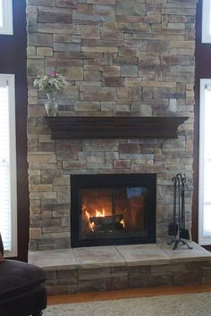 Refaced fireplace with manufactured stone veneer.Ideas in changing family room fireplace. Reface Fireplace, Brick Fireplace Makeover, Home Fireplace, Fireplace Remodel, Living Room With Fireplace, Fireplace Surrounds, Fireplace Mantels, Fireplace Ideas, Mantel Shelf