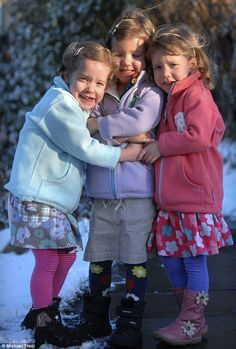 Miracle triplets winter hug.