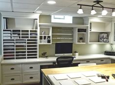 Love all the shelves and cubbis.  Scrapbooking Room - traditional - home office - detroit - Millennium Cabinetry