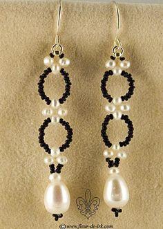 Filigree black-n-white earring by Fleur-de-Irk.devi...
