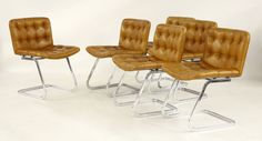 A set of six chrome and tan leather dining chairs Sold for £920 30th July 2014
