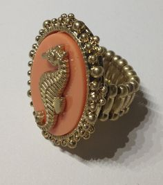 SEAHORSE CORAL RING  $11.00  free size