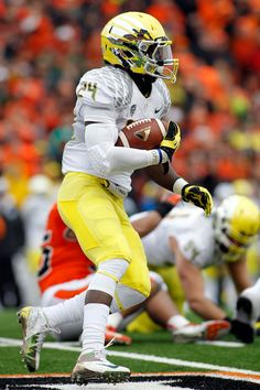"""Nov. 24 at Oregon State: Yellow helmet, white jersey and yellow pants. One comment on Twitter dubbed this the """"Buttered Popcorn"""" look. (Eric Evans photo) #GoDucks"""