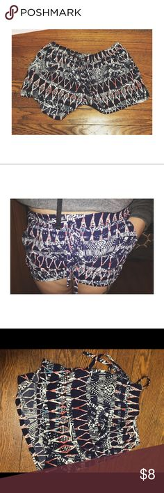 Patterned Shorts Patterned shorts that are lightweight and with pockets. Waist is elastic with a string. Shorts