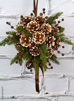 DIY Kissing Ball with Pine Cones - Crafts Unleashed Need an alternative to the traditional winter wreath? This beautiful pine cone DIY kissing ball is the perfect option - we'll show you how to make your own! Christmas Pine Cones, Rustic Christmas, Simple Christmas, Christmas Wreaths, Christmas Ornaments, Christmas Design, Primitive Christmas, Christmas Christmas, Thanksgiving Holiday